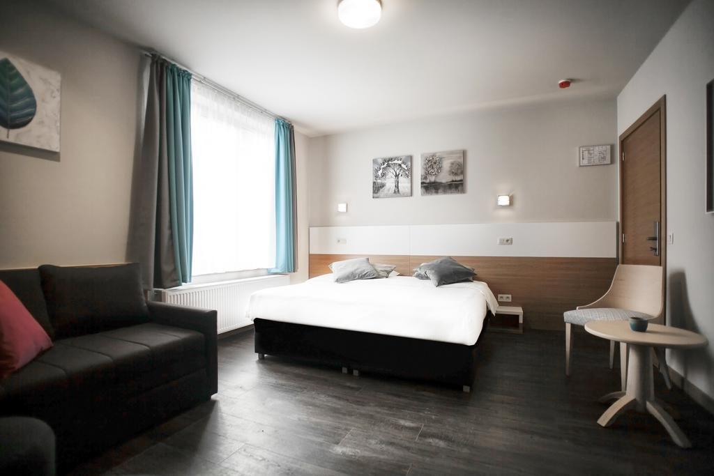 Foto de la cama muy amplia donde dormir en Amberes.
